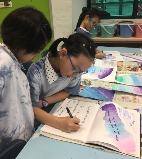 Practising their calligraphy skills during the P6 Leaders Workshop 1.jpg