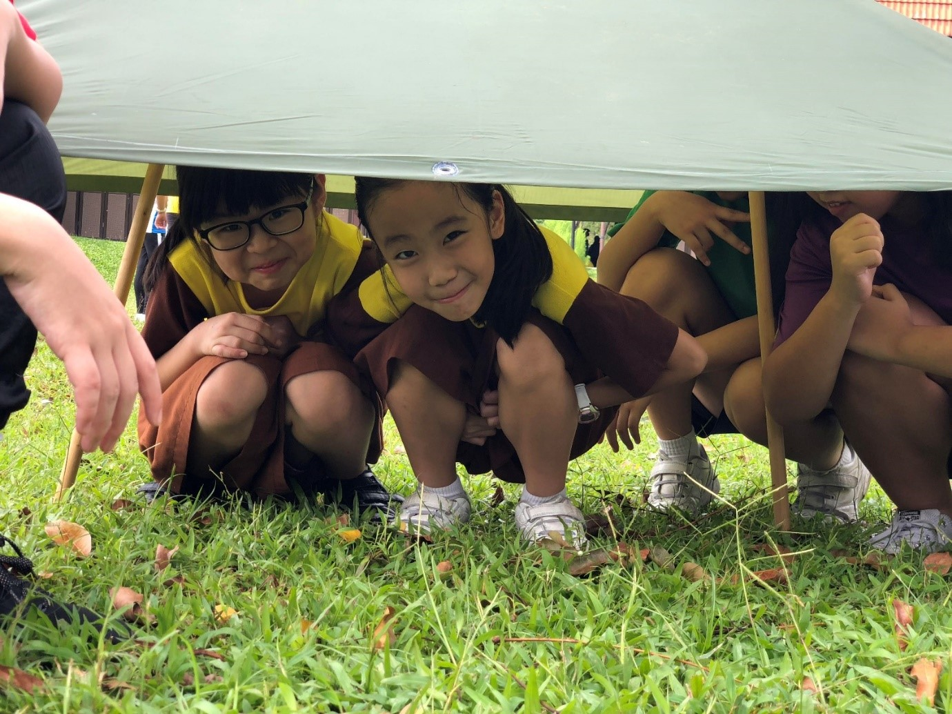 Sheltering ourselves under the Emergency Shelter that we just built!.jpg
