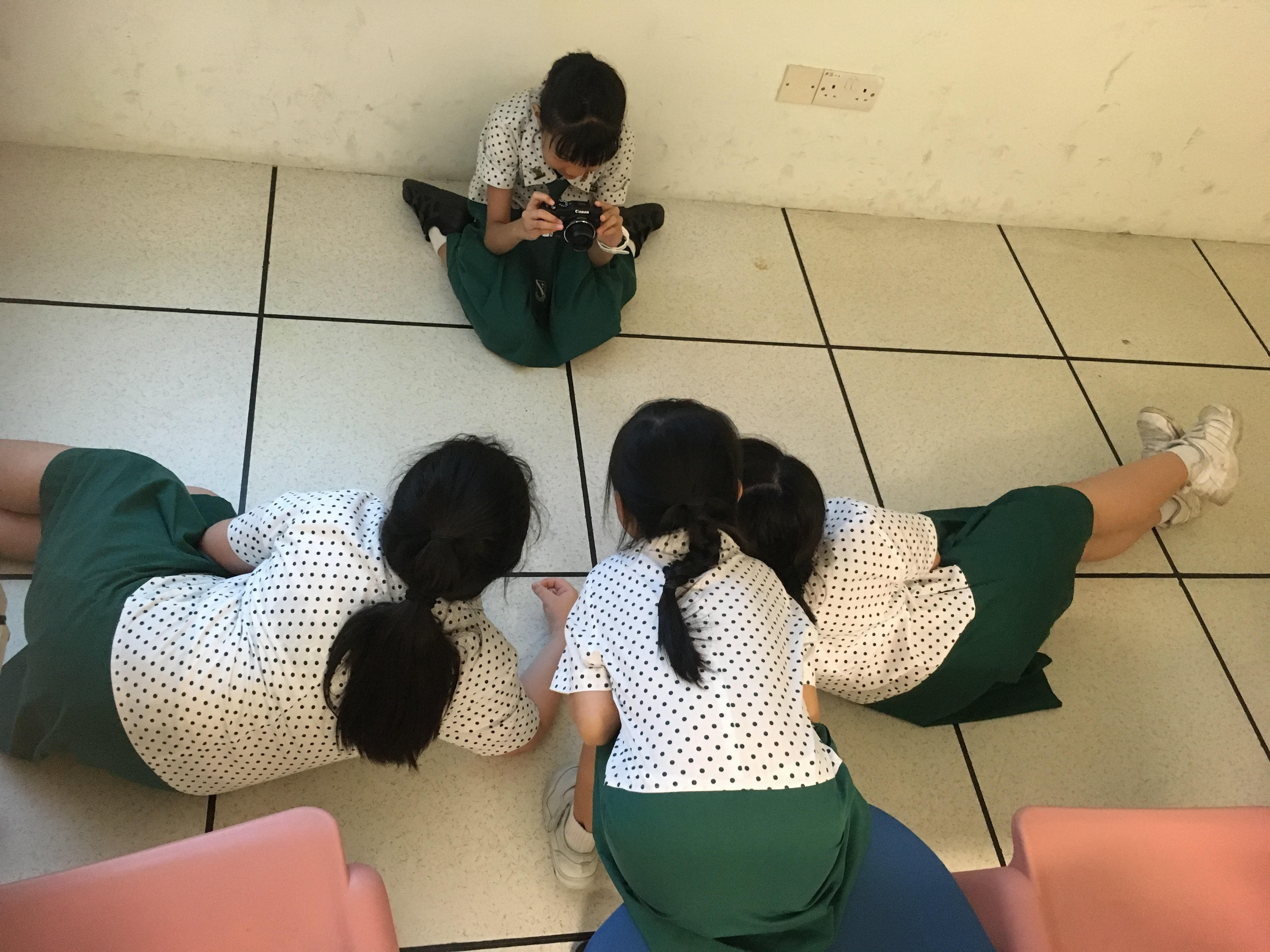 Girls learning to take photos from different angles.JPG